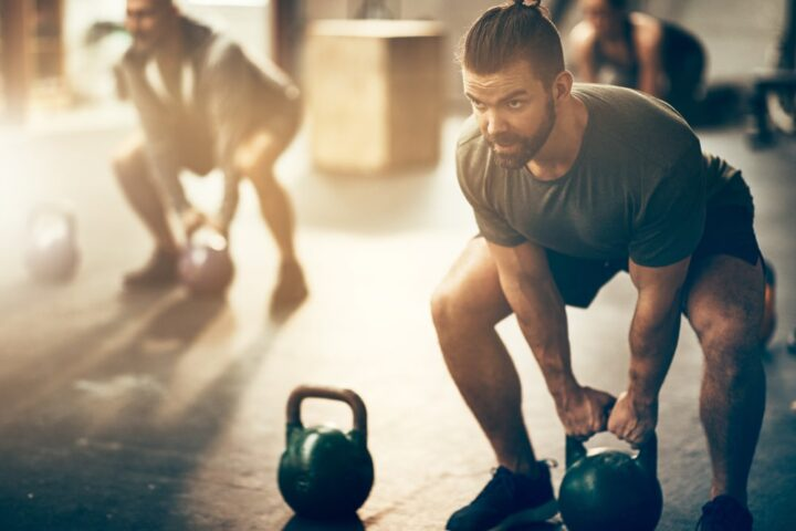 Man working out with kettlebells
